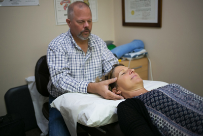 Tom performing CranioSacral therapy